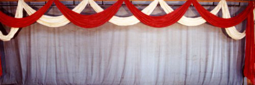 Red and White Ribbon Festoon Backdrop